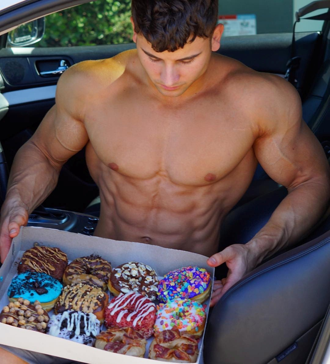 huge-shirtless-muscled-ripped-dude-eating-sweet-donuts
