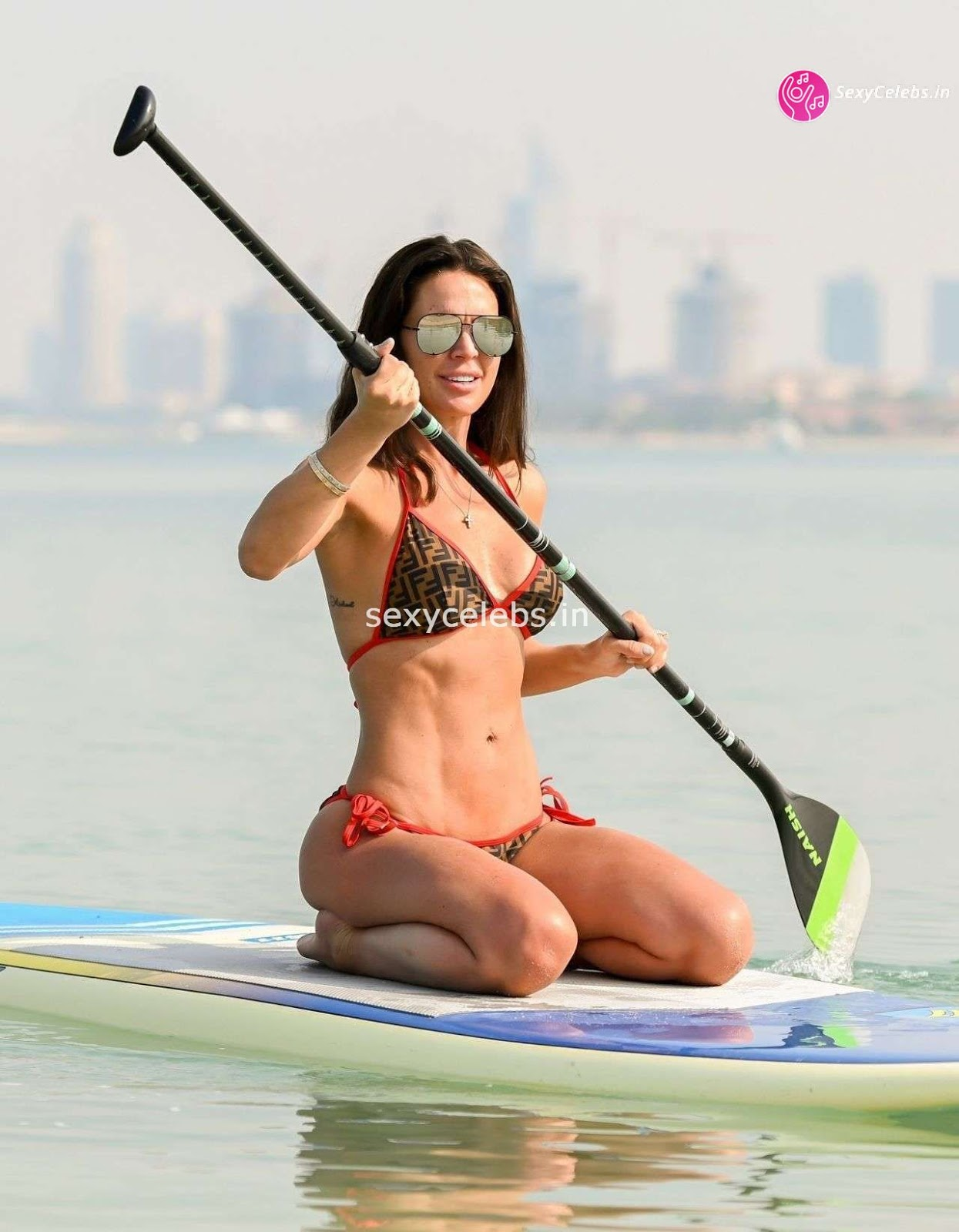 Danielle Lloyd ultra Sexy body huge tits sexy ass in tiny bikini WOW Beach Side Hot Pics