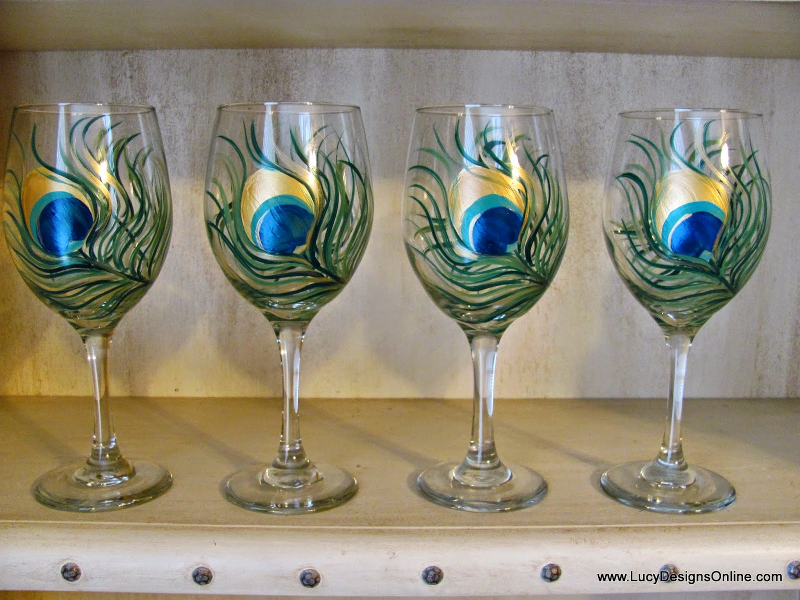 hand painted peacock feather design wine glasses