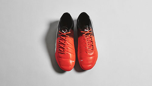Puma-evoPOWER-1.3-with-Shocking-Orange-Black-and-White-4