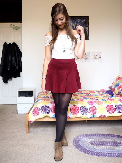 Disneybound outfit inspired by Jane Porter from Tarzan, of white lace crop top, burgundy red skater skirt, and brown suede ankle boots