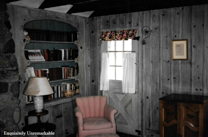 Paneled Living Room with books on shelves