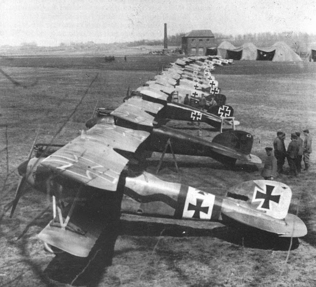 Photo of the Red Baron's Albatros, second from the front in a long row of German airplanes. Unit tents in the background. Dogfights and other stories of pilots. marchmatron.com