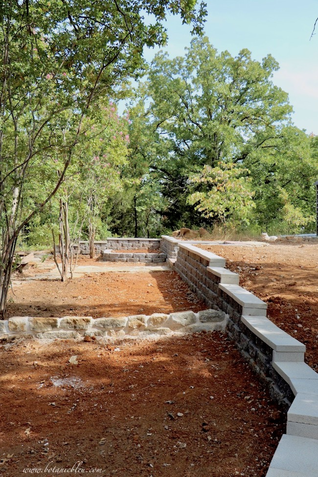 New Backyard Gray Paver Retaining Wall With Terraces