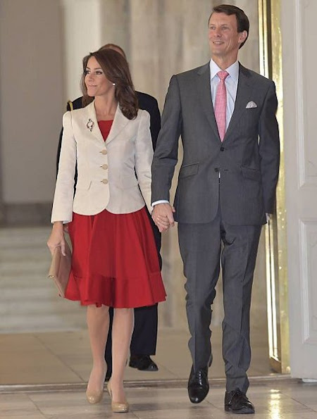Crown Princess Mary wore Dolce & Gabbana Purple Long-sleeve Floral-lace Scalloped Sheath Dress. Gianvito Rossi Pumps, Prada Clutch, Prada bag, Joseph Oslo Coat, LK Bennett