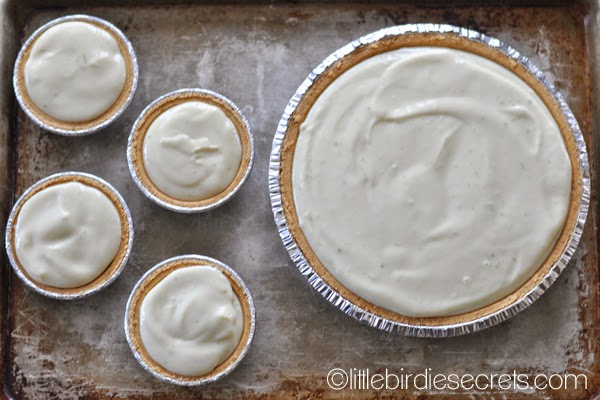 key lime pies on a baking sheet