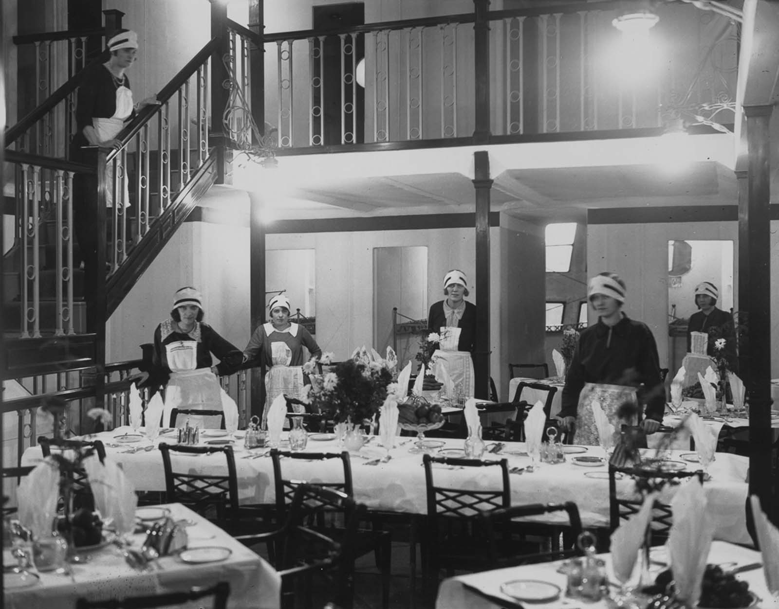 The lounge is rearranged as a dining room for meals. 1929.
