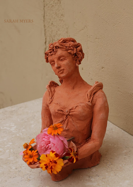 A Sculpture - with some flowers - Art by Sarah Myers