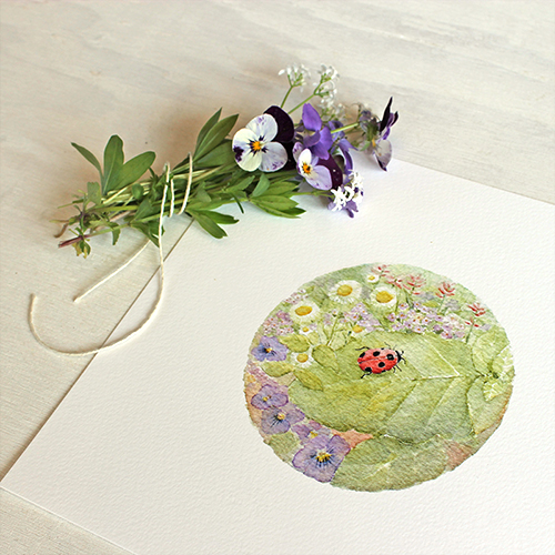 Watercolor painting of ladybug and flowers