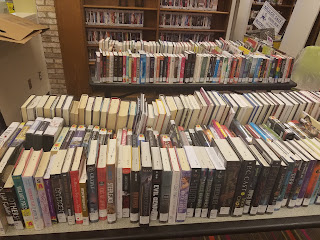 Library books on tables awaiting sorting and reshelving