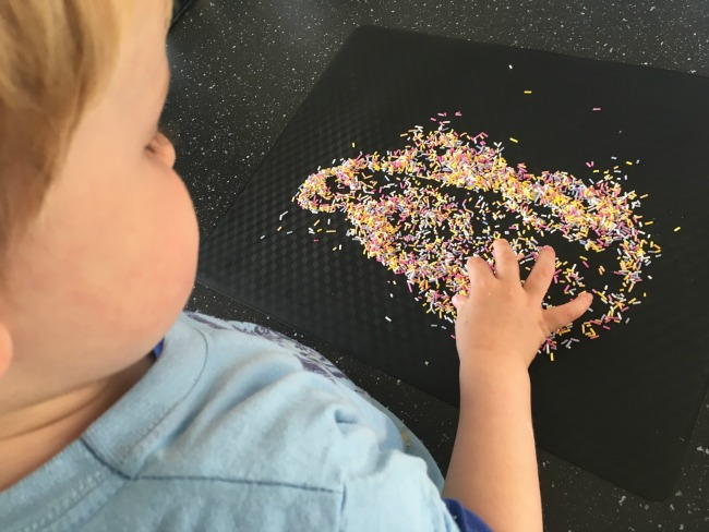 toddler-spreading-sprinkles-out