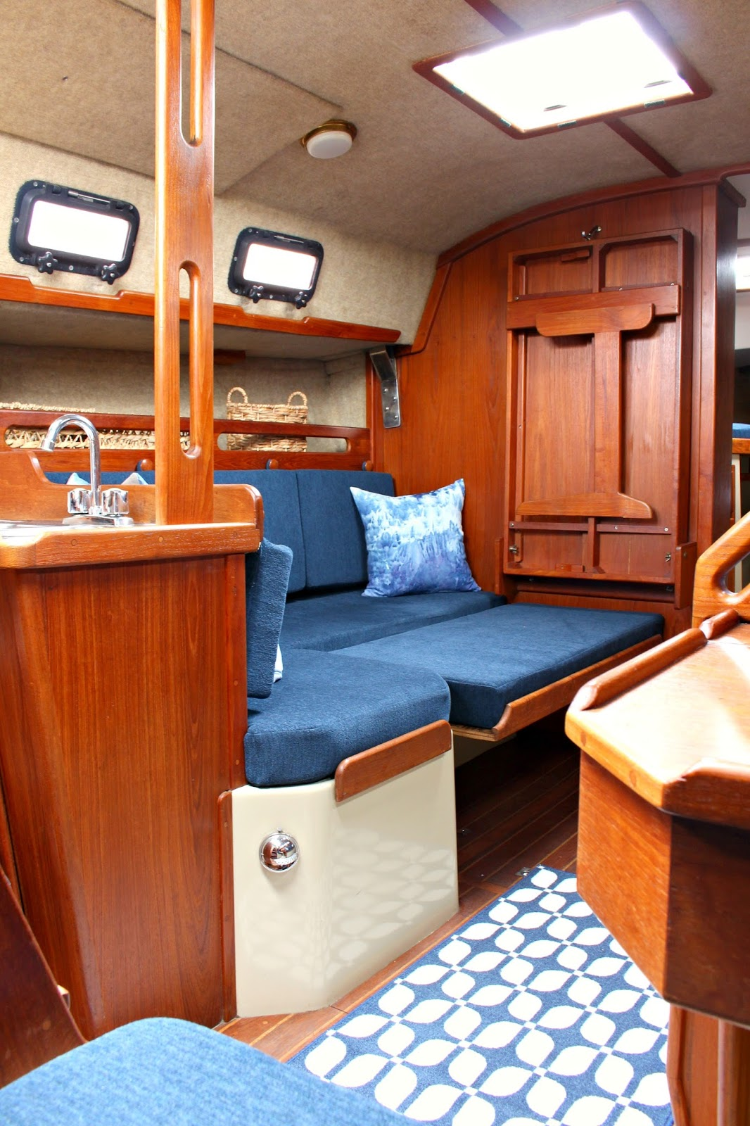 Ahoy tour our updated ticon 30 sailboat interior dans for Boat interior design ideas home