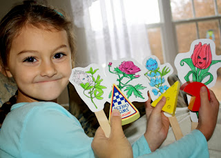 "Tessa and I acted out ""Lupe's Story"" with Flower Friends craft stick puppets. Tessa loved this part of earning Lupe's petal. It was her idea to use her wooden cheese as props."