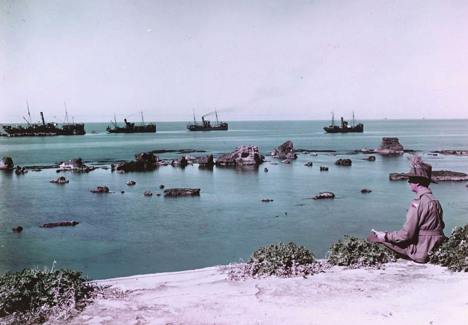 The Rocks of Andromeda, Jaffa, and transports laden with war supplies headed out to sea in 1918. This image was taken using the Paget process, an early experiment in color photography.