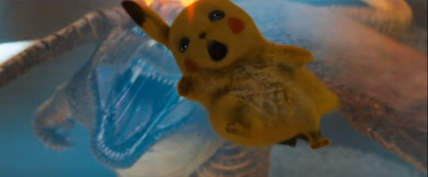 POKÉMON Detective Pikachu 2019 Movie featuring live action Charizard about to bite a falling Detective Pikachu