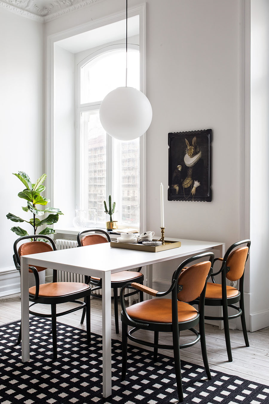 Scandinavian interior, dining room, black and white carpet, bright apartment