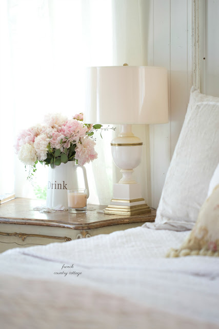 peonies on nightstand in french cottage bedroom