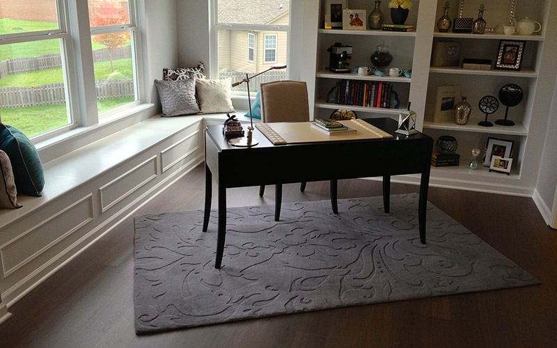 Wide planks and an offset area rug make this small space feel more open.