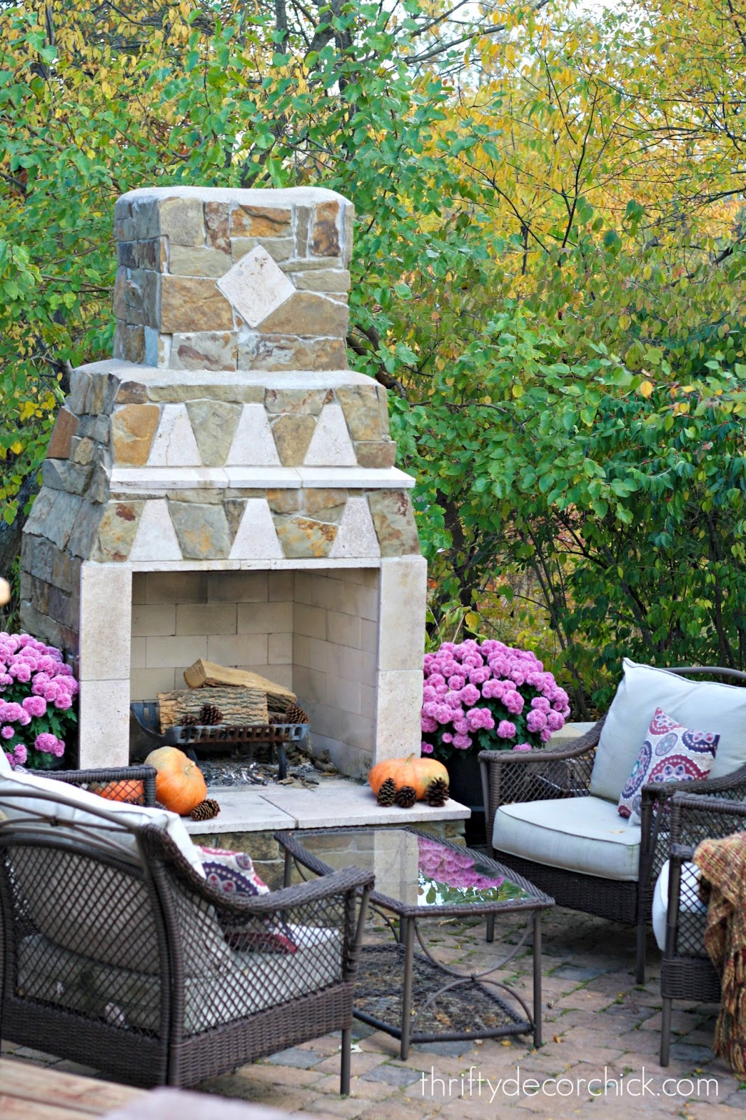 outdoor stone fireplace on patio