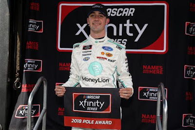 Austin Cindric poses for a photo after winning the pole award  during qualifying for the XFINITY Series Drive for the Cure 200