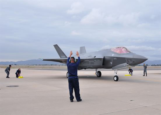 Image Attribute: Lockheed Martin and Japanese Air Self-Defense Force personnel work together to taxi in the arrival of the first Foreign Military Sales F-35A onto the 944th Fighter Wing ramp Nov. 28 at Luke Air Force Base, Ariz. The arrival marked the next step for the international F-35 training program. (U.S. Air Force photo by Tech. Sgt. Louis Vega Jr.) / Source: U.S. Department of Defense