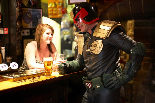 judge dredd cosplayer having a beer