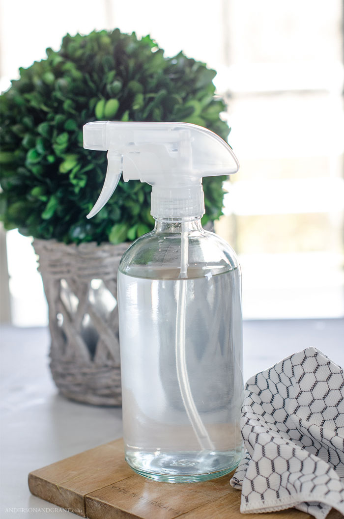 Make all natural cleaner for your windows and glass with just two common ingredients. #homemadecleaner #DIY #homekeeping #cleaning #andersonandgrant