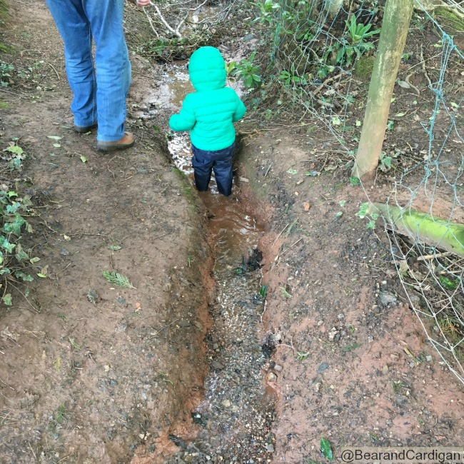 toddler walking in stream