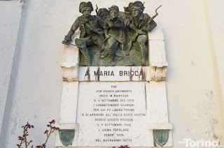 The monument to Maria Bricca, in bronze, again shows her at the forefront of the assault in Pianezza castle