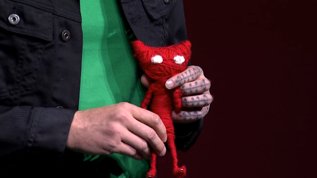 Unravel Martin Sahlin hand tattoo voodoo doll Yarny videogame EA E3