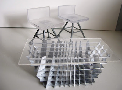 Two modern dolls' house miniature white and grey bar stools from the Kaleidoscope House and a SLICE Tilt coffee table.
