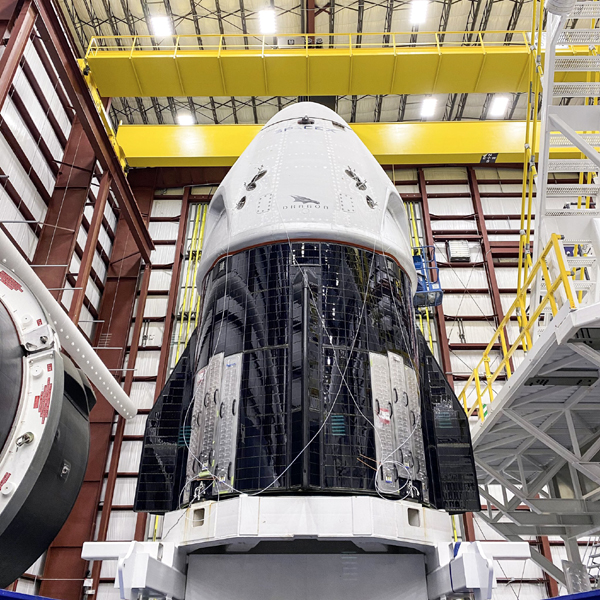 The Crew Dragon Demo-2 capsule prior to it being attached to its Falcon 9 rocket inside SpaceX's Horizontal Integration Facility...on May 20, 2020.