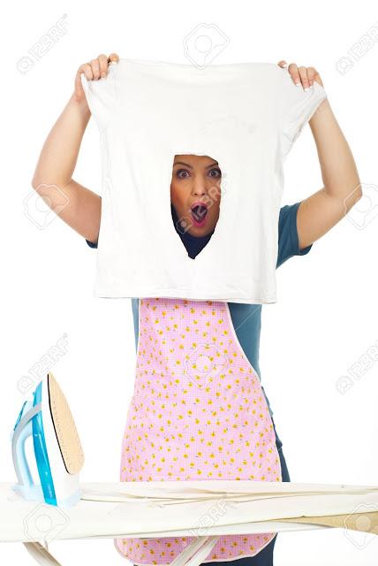 pembantu rumah lubangkan baju ketika menggosok baju