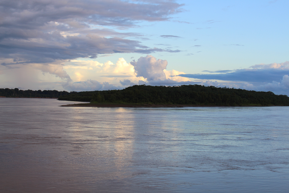Madre de Dios river at sunset, Peru - travel & lifestyle blog