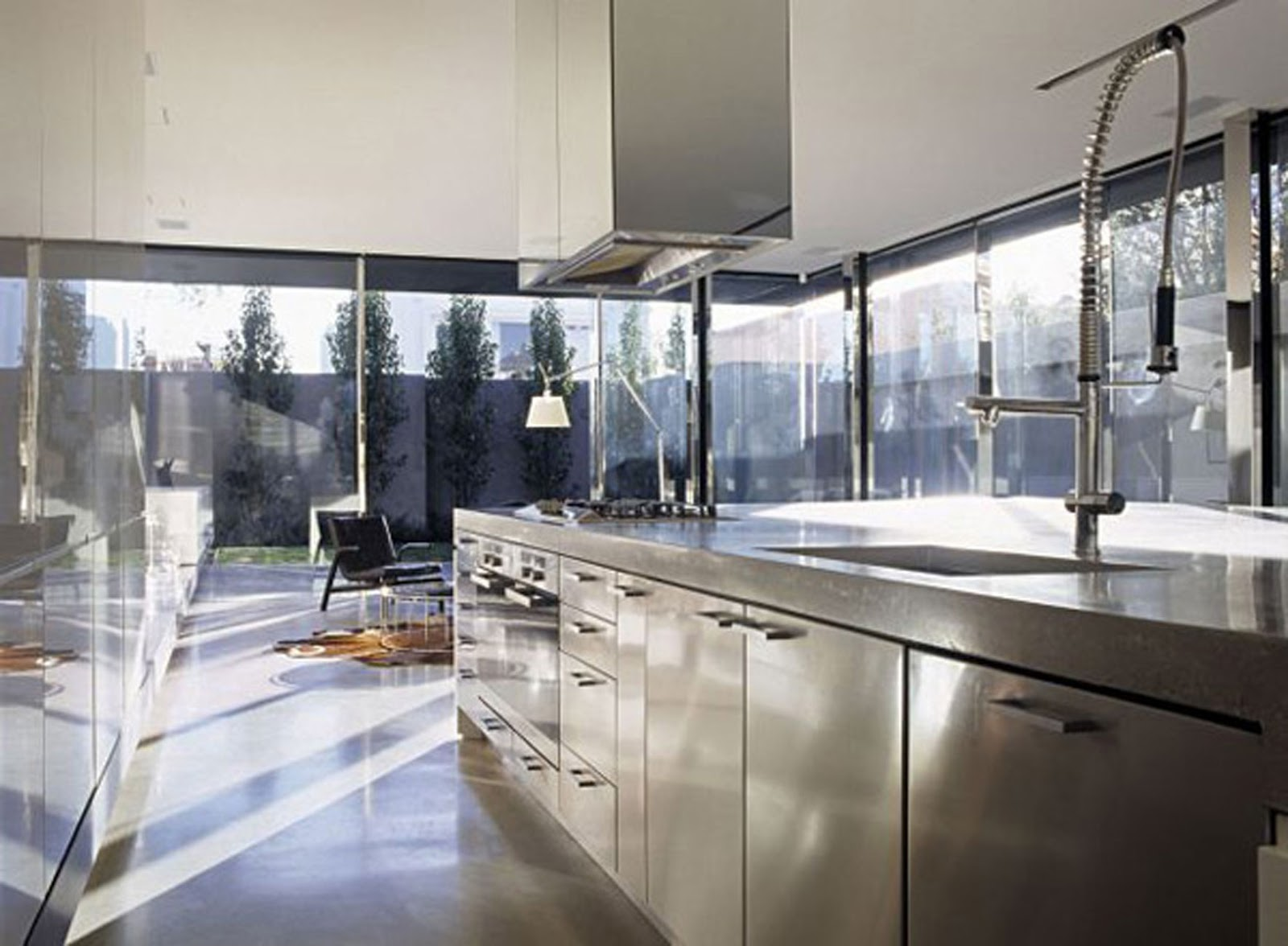 modern interior design for a contemporary concrete house in australia stainless steel kitchen