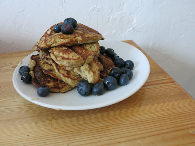pile of banana pancakes with blueberries