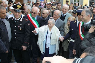 Crowds turned out in Novate Milanese as Maria arrived for a party to celebrate her 113th birthday