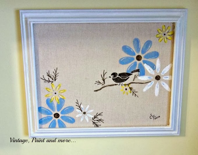 Stenciled Canvas - completed canvas of stenciled flowers and bird in white frame