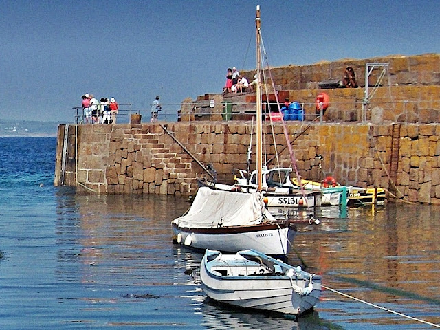 Harbour wall and boats at Mousehole, Cornwall
