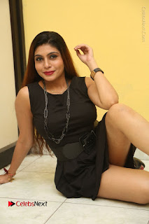 Tollywood Upcoming Actress Pooja Roshan Stills in Black Short Dress at Plus 1 Movie Trailer Launch  0254.JPG