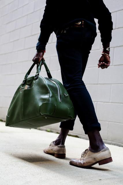 man wih arch bowling bag