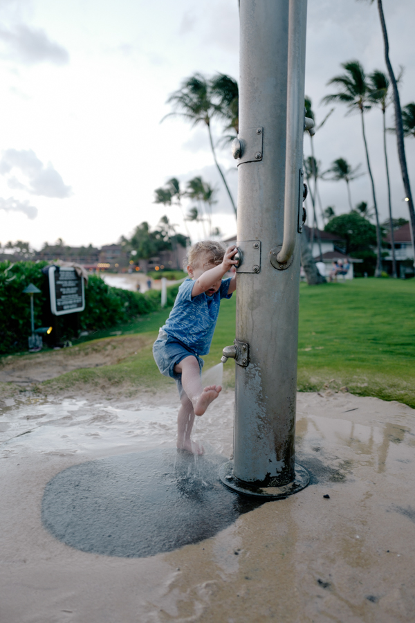 Washing the sand off of little toes - Kiahuna Plantation, Kauai