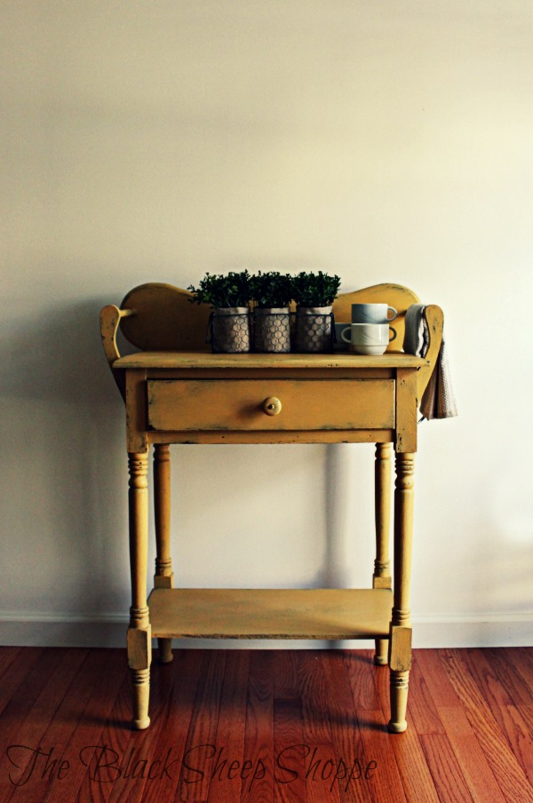 Vintage washstand painted in Arles with a pop of blue inside.