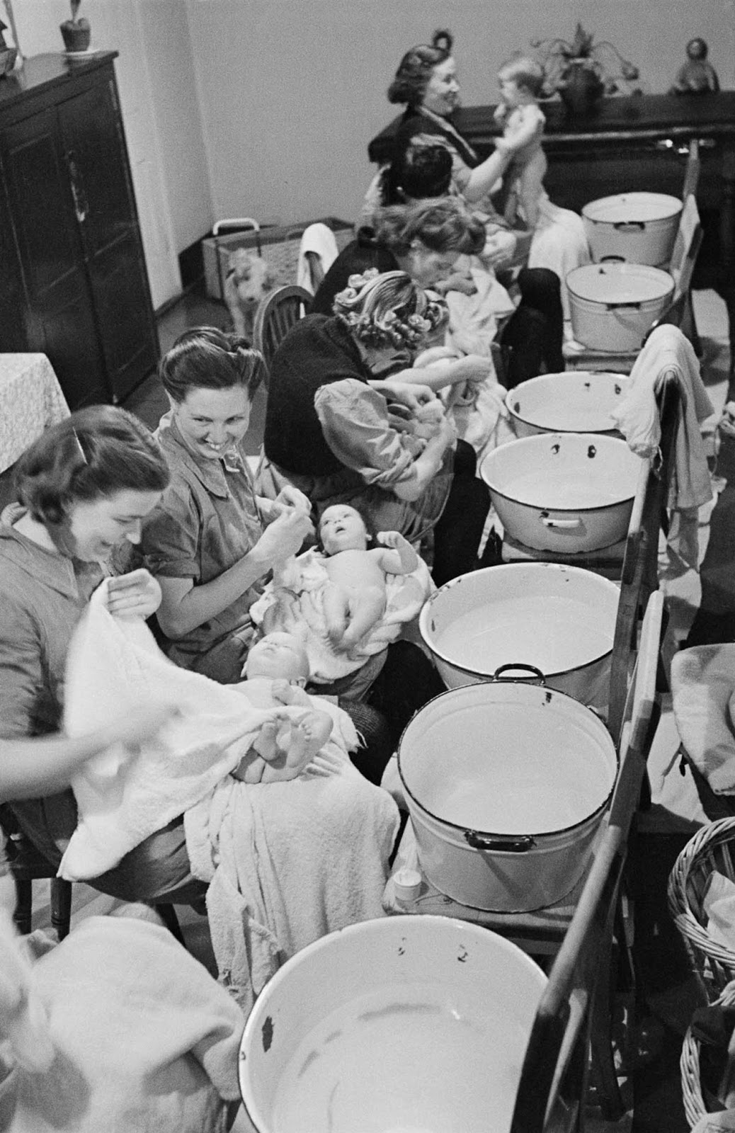 Prisoner mothers bathe their babies in a hospital ward at Holloway Prison in London, 1947.