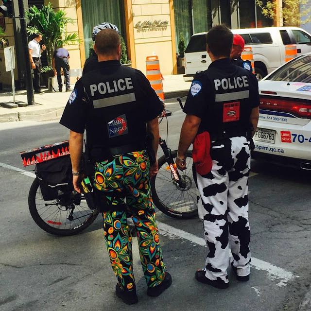 Montreal Police in peacock pants and cow-print pants. Police Pants Protest. marchmatron.com