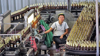A worker on duty at the state-owned Lao Brewery bottling plant.