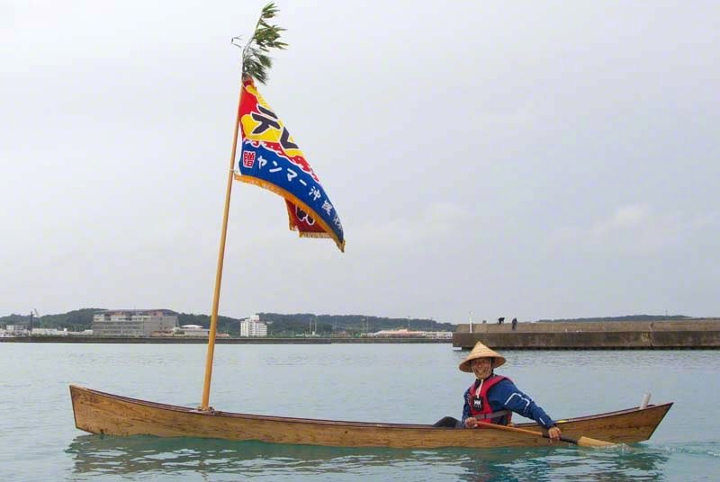 Man paddling traditional sabani sailing boat