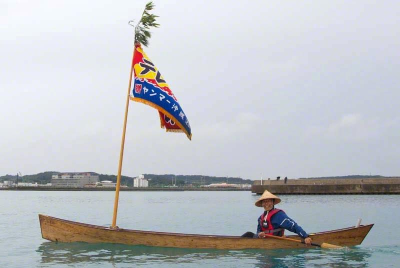 Man paddling traditional sabani sailing boat
