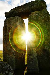 Stonehenge with sun shining through the gap, Whiltshire, UK