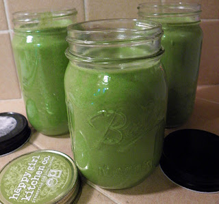 Green Smoothie in Three Pint Sized Mason Jars with Lids